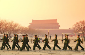Team of soldier walk by Tiananmen