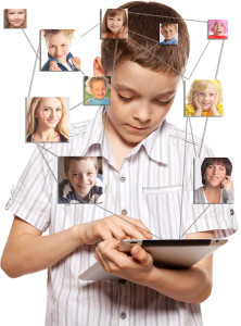 Kids in social network. Child looks to the tablet computer. Soci