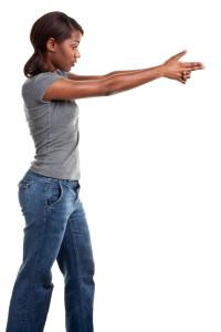 Woman Carrying a Gun